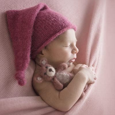 Emily Winnie Photography- Baby all tucked in with teddy