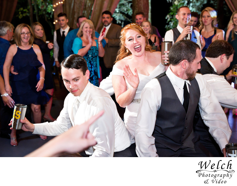 Bride laughing dancing reception Palmettos On The Bayou