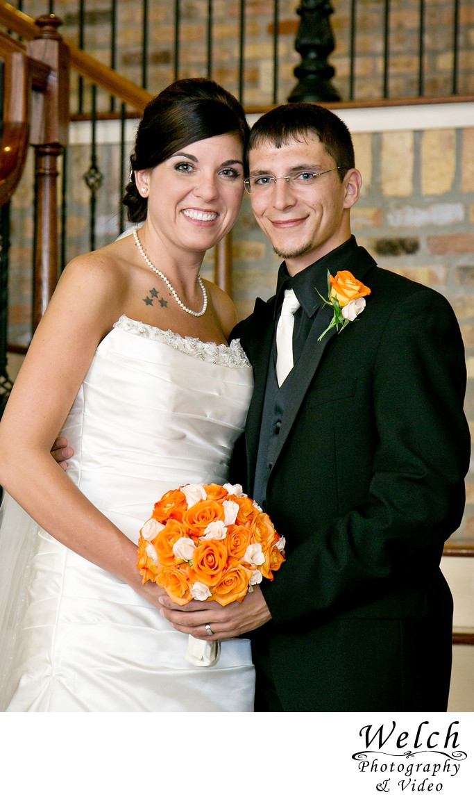 Bride groom portrait orange flowers Mandeville, Louisiana