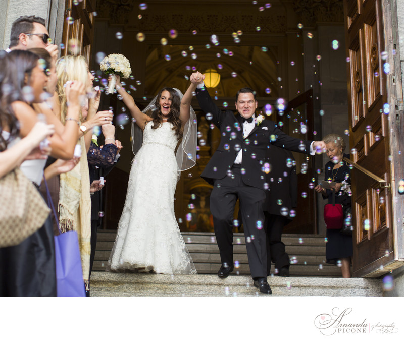 Bride and groom exit wedding ceremony with bubbles NYC