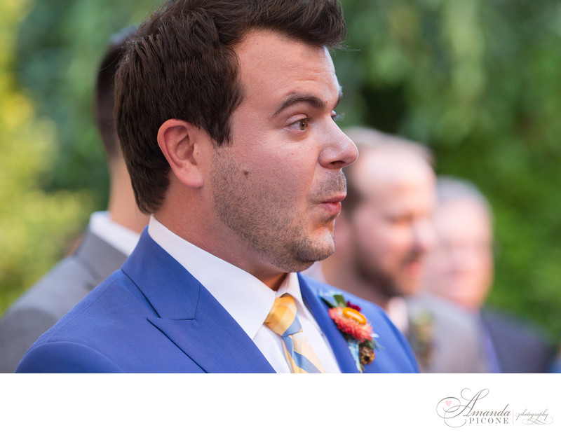 Groom reacts to seeing bride as she walks down aisle