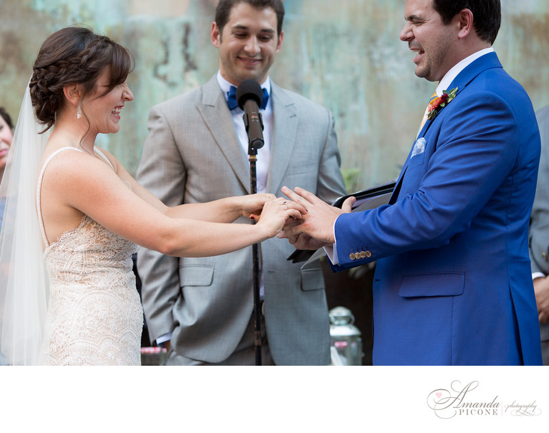 Bride puts on groom's ring at MyMoon Brooklyn Wedding Ceremony