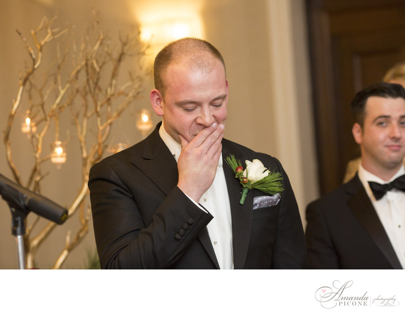 Groom overcome with emotion seeing bride at ceremony