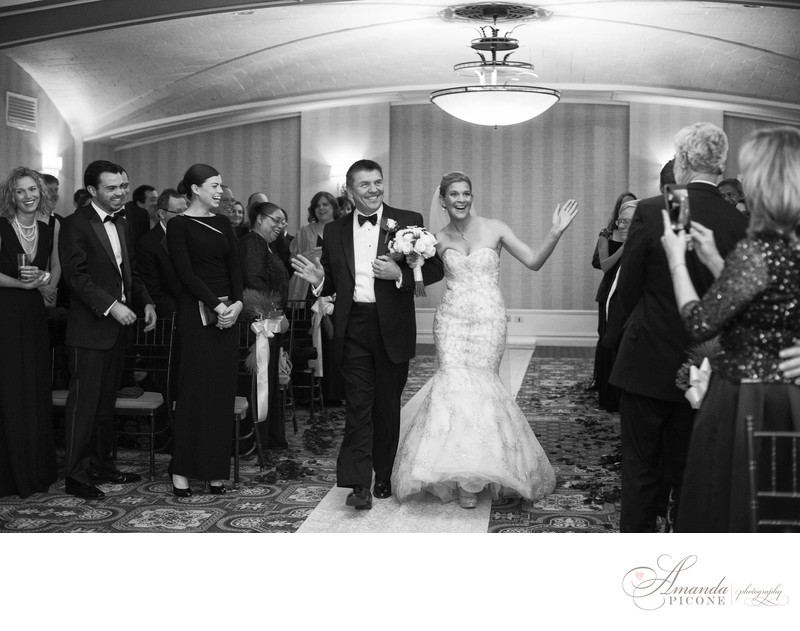 Bride and father dance down aisle during wedding ceremony