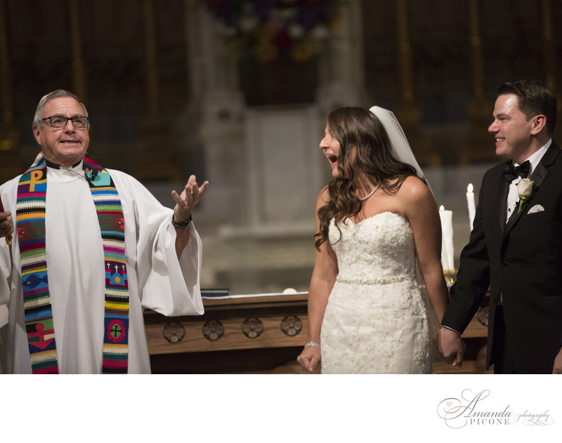 Bride and groom laugh with priest wedding ceremony in NYC