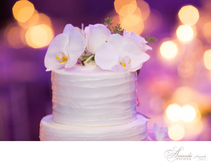 Wedding cake with buttercream frosting and orchids