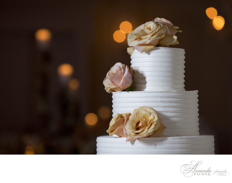 Wedding cake with roses and white buttercream frosting
