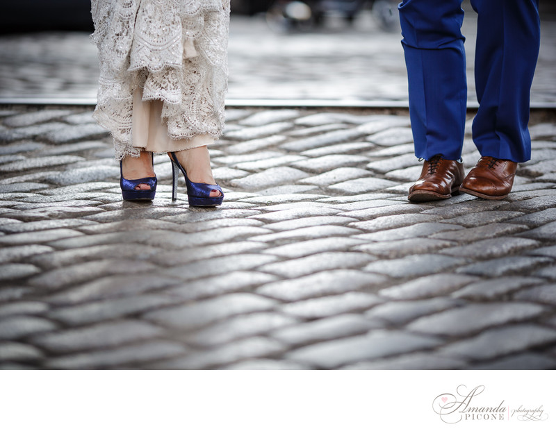 Bride and groom shoes on cobblestone street in Brooklyn NY