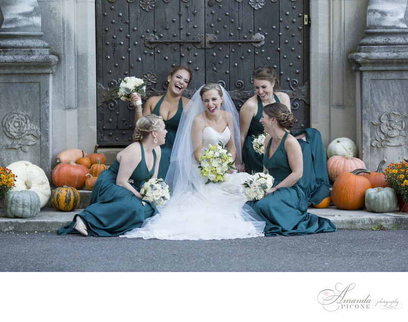 Bride and bridesmaids laugh with pumpkins Planting Fields