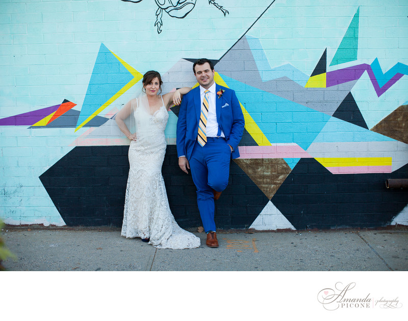 Bride and groom with graffiti wall in Williamsburg Brooklyn