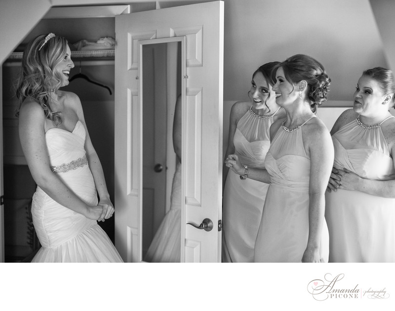 Bridesmaids see bride in wedding gown before ceremony