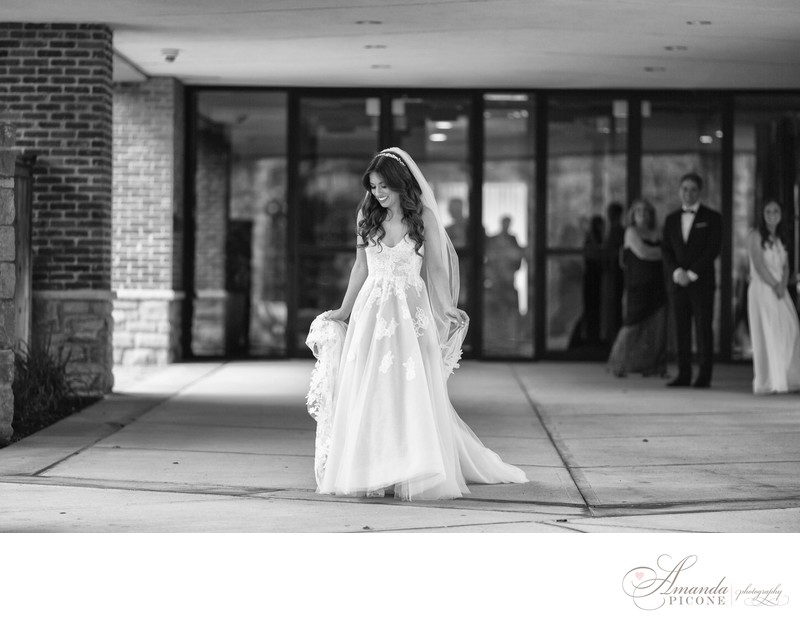 Bride walks to groom for first look at Temple Sinai
