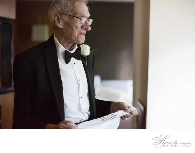 Bride's dad reads custom handkerchief before wedding