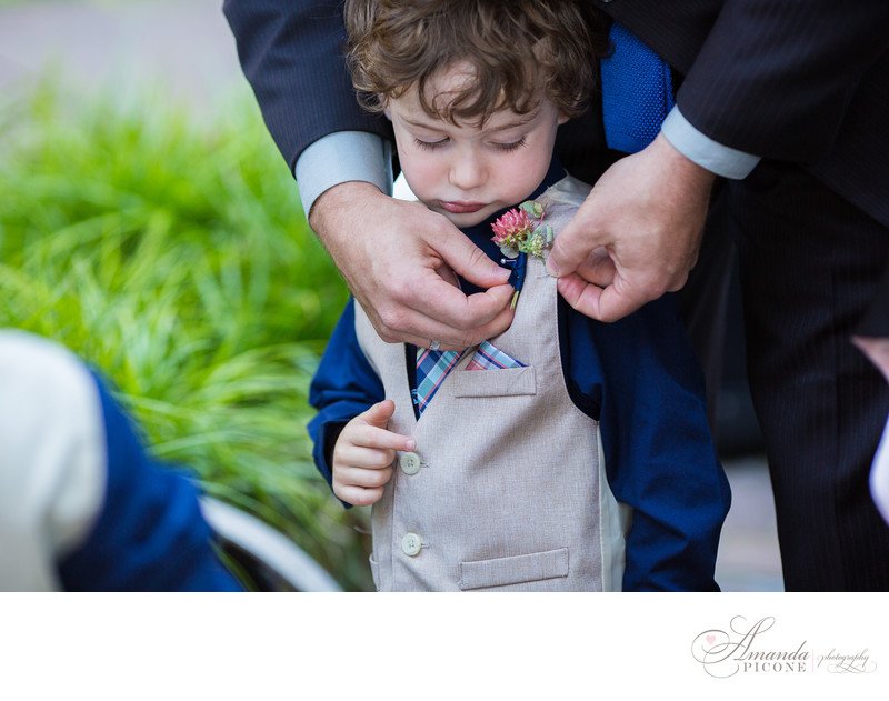 Ring bearer gets boutonniere before MyMoon Brooklyn wedding