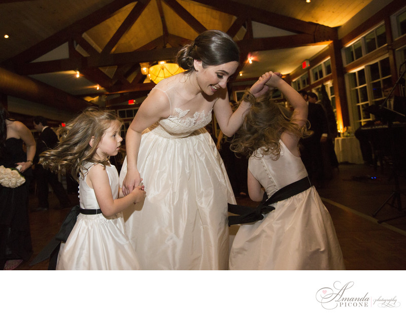 Bride dances with flowergirls Loeb Boathouse NYC