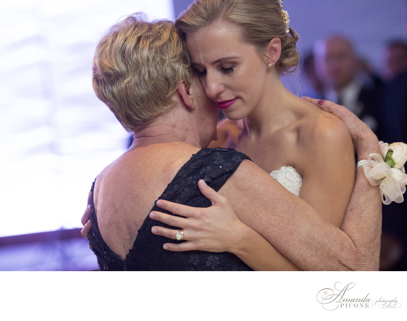 Bride and mom share a special dance during wedding