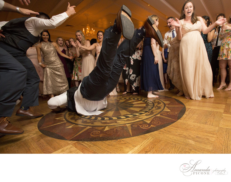 Guest does the worm at wedding reception