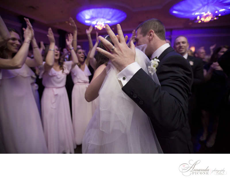 Wedding ring on groom during first dance with bride