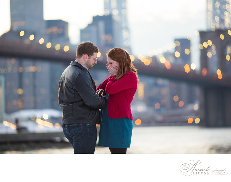 Surprise proposal photography at Brooklyn Bridge winter