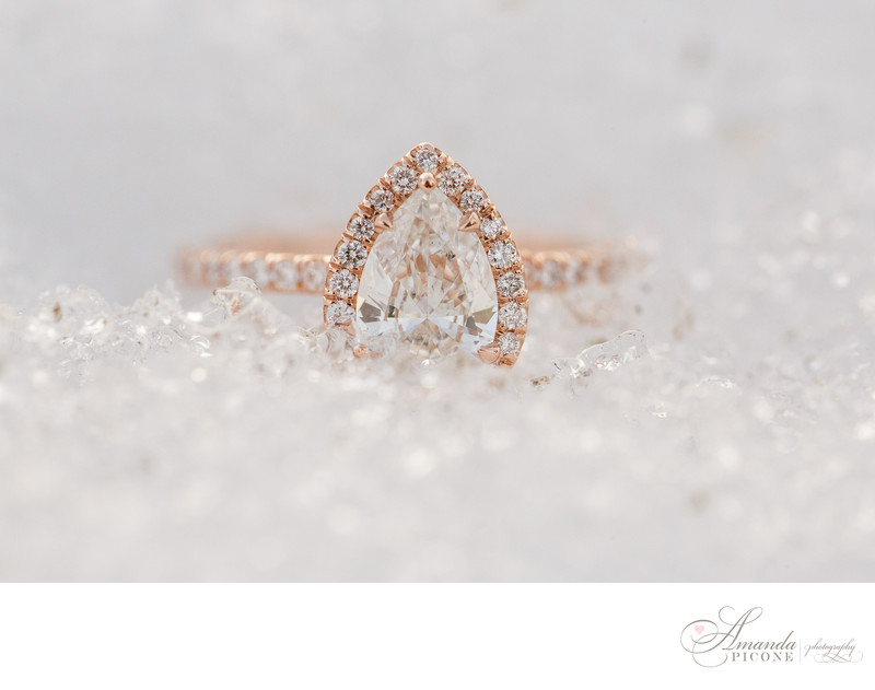 Pear Cut Halo engagement ring in the snow NYC photography