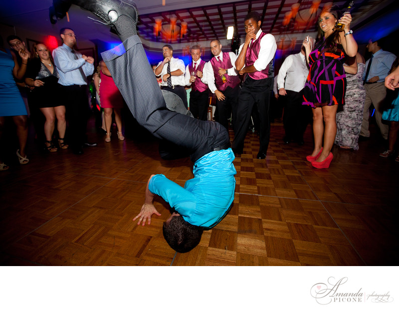 Guest breakdancing at wedding reception