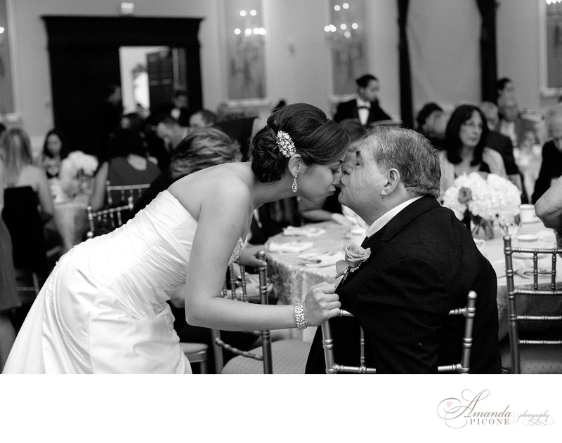 Bride's father kisses her nose at wedding reception