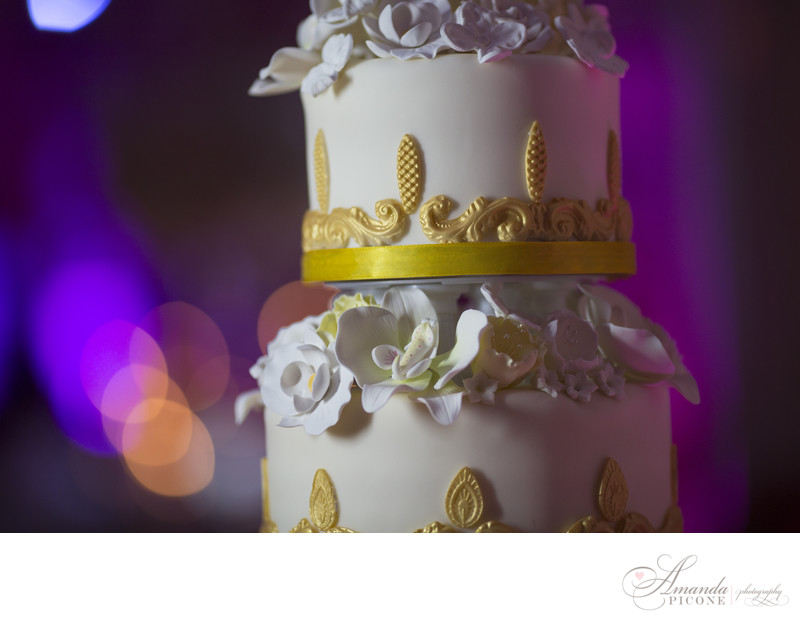 White and gold wedding cake at Bourne Mansion NY