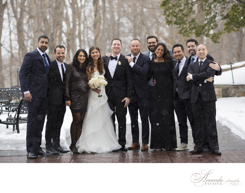 Bride and groom with wedding guests in snow Tappan Hill