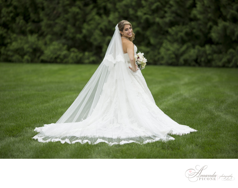 Bride alone in gown at Flowerfield in Long Island NY