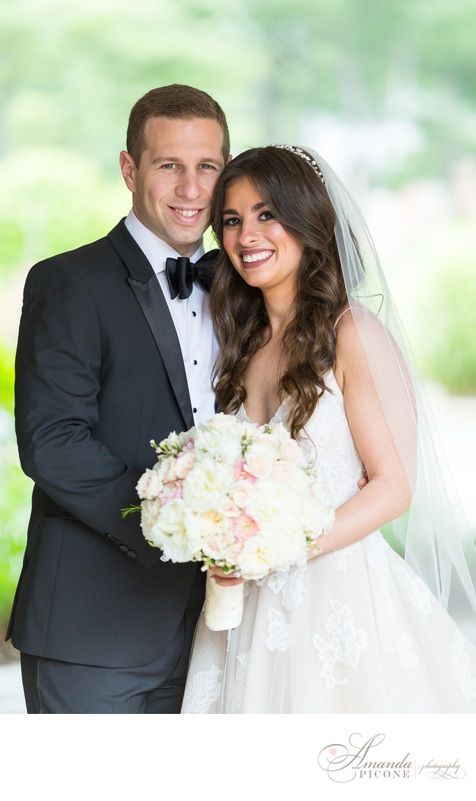 Bride and groom posing at Temple Sinai Long Island