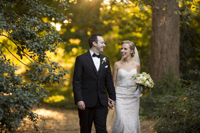 Bride and Groom walking at Planting Fields Long Island