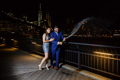 Brooklyn champagne engagement photos NYC Manhattan Skyline