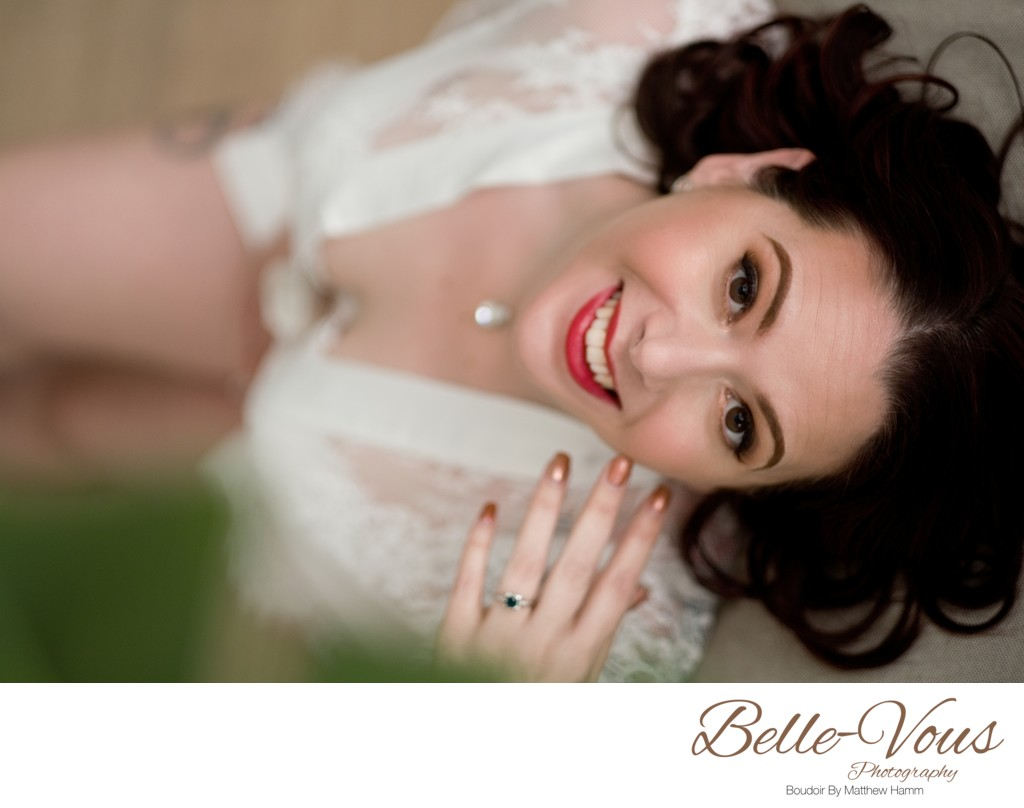 Bride posing for boudoir photograph