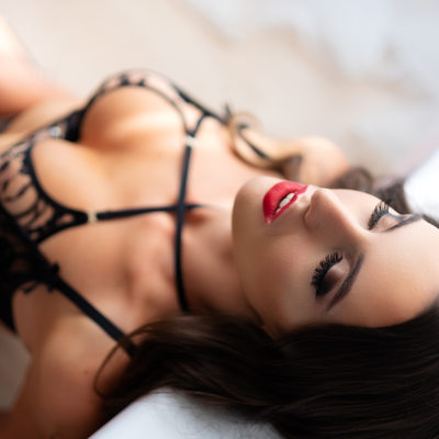 Boudoir Posing On The Floor With Black Lingerie And Red Lips