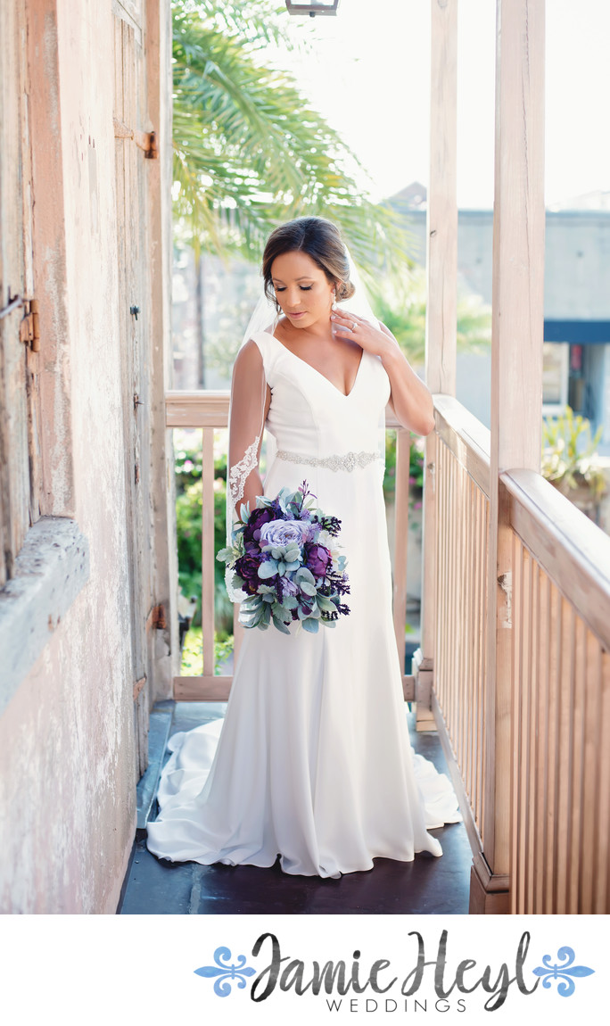 Race and Religious balcony bridal portrait