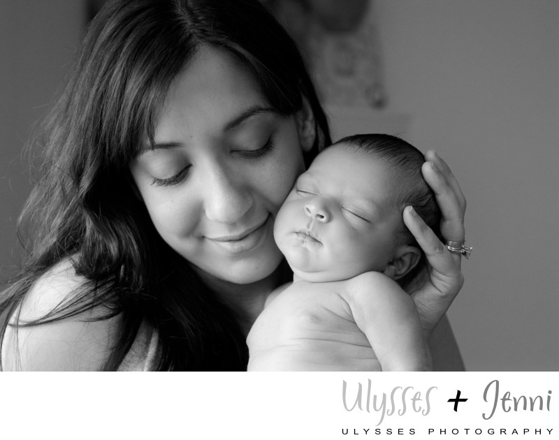 Joyous Mom and Newborn in Black and White