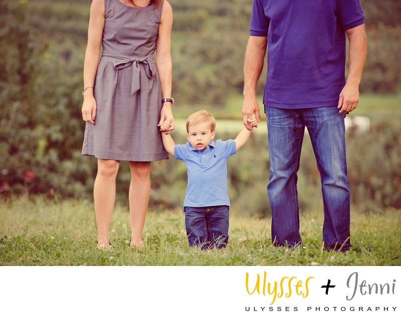 BOY PORTRAIT WITH PARENTS IN FIELD