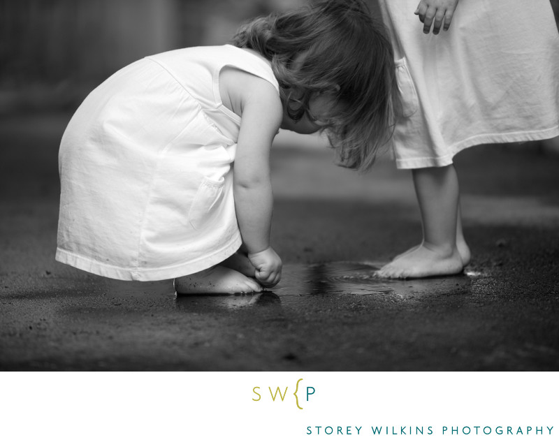 Storey Wilkins Photography kids Photography Puddles