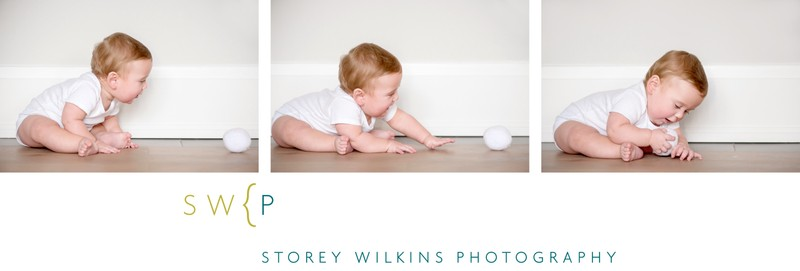 Baby Plays with Fluffy Ball During Portrait Session