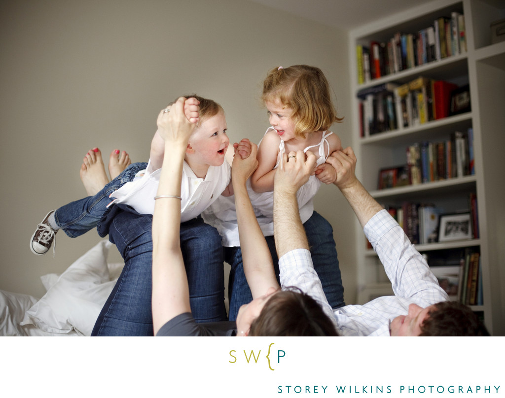Fun Family Photography | Playing Airplane on the Bed