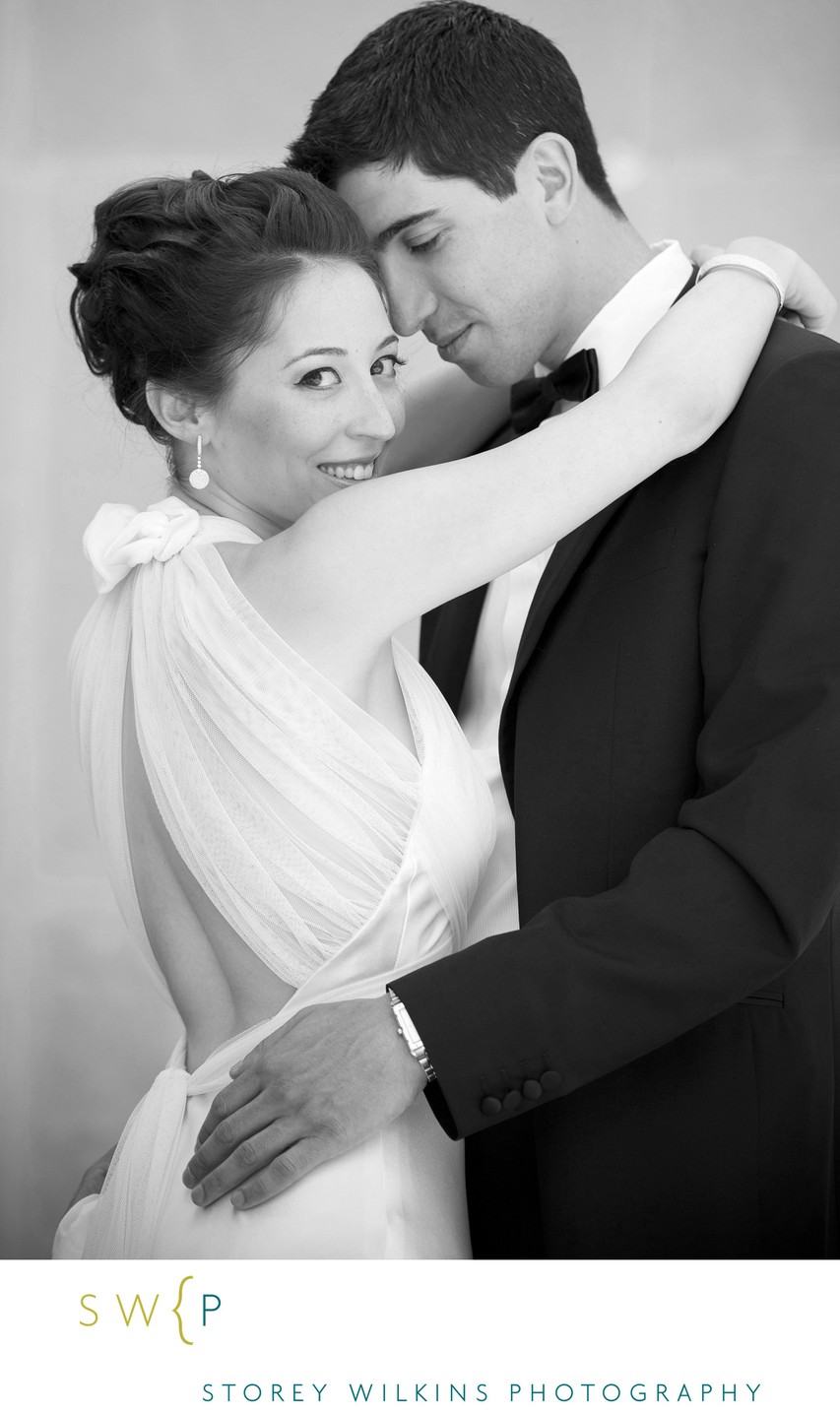 Gentle Embrace and Tender Smile at Temple Sinai Wedding