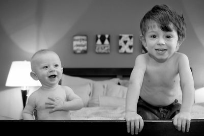 Adorable Big Brother and Little Brother Photo on Bed
