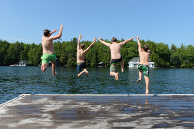 Running and Jumping Off the Dock at the Cottage