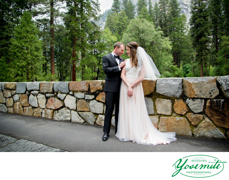 Bride And Groom On Bridge At Majestic Yosemite Hotel