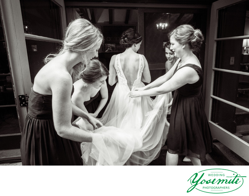Bridemaids Help Bride Into Her Gown At majestic Yosemite Hotel