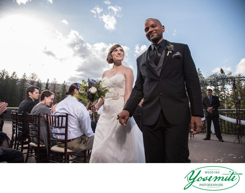 Bride Beams At Groom On Recessional At Tanaya Lodge Wedding