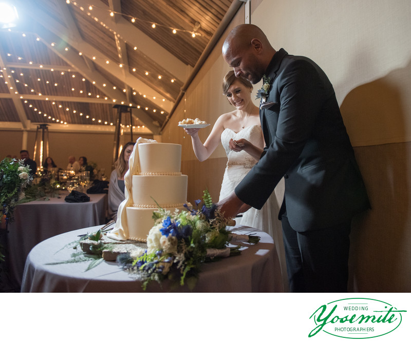 Bride And Groom Cut The Cake At Tenaya Lodge Wedding