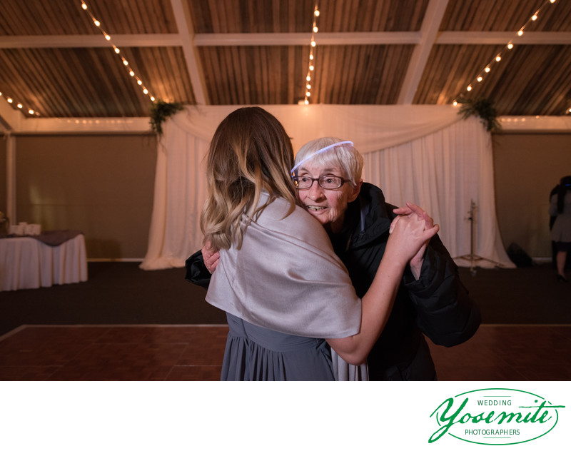 Bridesmaid Dances With Grandma Glow Stick On Her Head