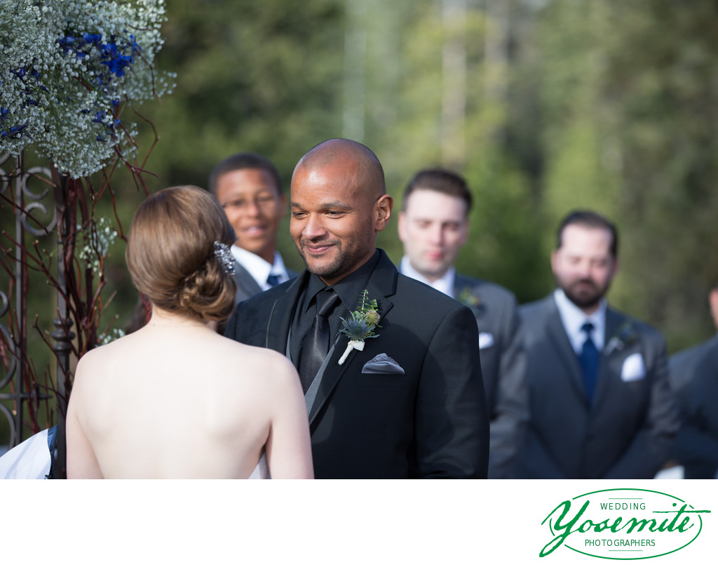 Groom Beams At Bride During Tenaya Lodge Wedding Ceremony.
