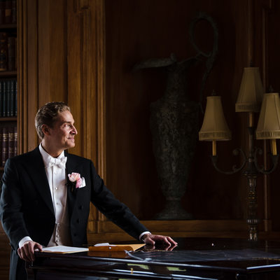 Timeless Portrait of the Groom at Oheka Castle Library
